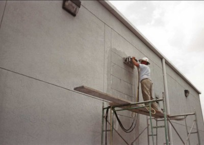 Hand Sawing on Wall